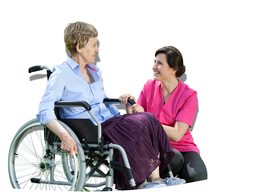 An elderly in a wheelchair talking to a caregiver